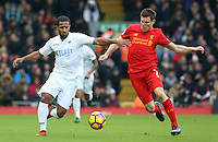 Wayne Routledge of Swansea City is challenged by James Milner (vice-captain) of Liverpool during the Premier League match between Liverpool and Swansea City at Anfield, Liverpool, Merseyside, England, UK. Saturday 21 January 2017