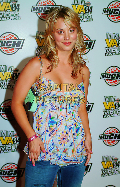Kaley Cuoco .arrives at the MMVA After Party hosted by Maxim at Lucid Nightclub,  Toronto, Ontario, Canada, 20th June 2004..half length jeans print top  green cami camisole bag  .CAP/ADM/BPC.©Brent Perniac/AdMedia/Capital Pictures.