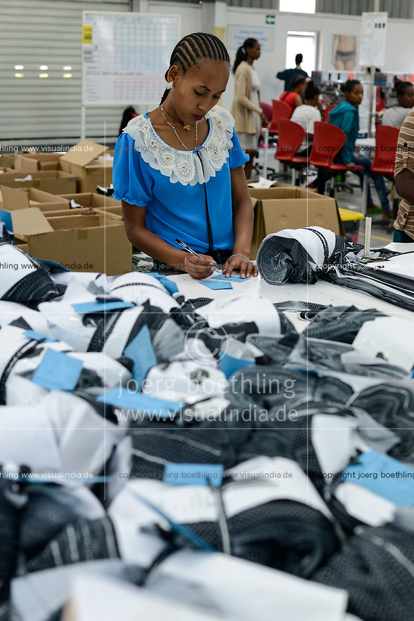 ETHIOPIA , Southern Nations, Hawassa or Awasa, Hawassa Industrial Park, chinese-built for the ethiopian government to attract foreign investors with low rent and tax free to establish a textile industry and create thousands of new jobs, textile company Hela Indochine Apparel PLC a joint venture of sri lankan and chinese companies / AETHIOPIEN, Hawassa, Industriepark, gebaut durch chinesische Firmen fuer die ethiopische Regierung um die Hallen fuer Textilbetriebe von Investoren zu vermieten, Textilfabrik Hela Indochine Apparel PLC