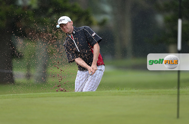 Michael Hoey (NIR) finds the bunker on the 11th and chip in close to hold par during Round One of The Nelson Mandela Championship 2013 presented by ISPS Handa, at the Mount Edgecombe Country Club, KwaZulu-Natal, South Africa. Picture:  David Lloyd / www.golffile.ie