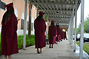 PEMBROKE PINES, FL - MAY 15: Students wearing protective masks wait six feet apart during their graduation ceremony at Pembroke Pines Charter High School on May 15, 2020 in Pembroke Pines, Florida. Because of social distancing mandates instituted by the state to curtail the spread of COVID-19, the 2020 graduates received their diplomas in a near-empty auditorium with no friends, family or relatives allowed to attend. A video of each student walking the stage to receive their diploma will be streamed on the school's scheduled graduation date of May 29.   ( Photo by Johnny Louis / jlnphotography.com )