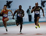 SHANGHAI, CHINA - MAY 19:  Asafa Powell (R) of Jamaica, Nesta Carter of Jamaica and Bingtian Su of China compete in the Men 100m during the Samsung Diamond League on May 19, 2012 at the Shanghai Stadium in Shanghai, China.  Photo by Victor Fraile / The Power of Sport Images