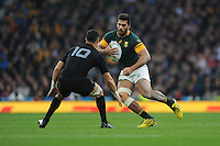 Damian de Allende of South Africa faces up to Dan Carter of New Zealand during the Semi Final of the Rugby World Cup 2015 between South Africa and New Zealand - 24/10/2015 - Twickenham Stadium, London<br /> Mandatory Credit: Rob Munro/Stewart Communications
