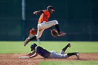 San Francisco Giants Jalen Miller (15) jumps over a sliding Kevin Padlo (37) during an instructional league game against the Colorado Rockies on October 7, 2015 at the Giants Baseball Complex in Scottsdale, Arizona.  (Mike Janes/Four Seam Images)