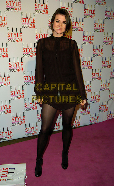 HOLLY DAVIDSON.Leaving the ELLE Style Awards, The Roundhouse, Chalk Farm Road, London, UK..February 12th 2007.full length black dress skirt top sheer .CAP/CAN.©Can Nguyen/Capital Pictures