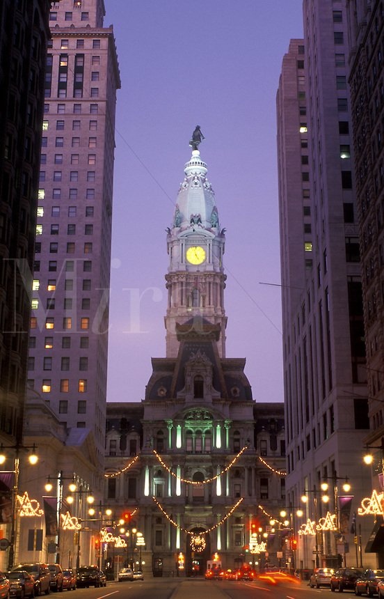 Philadelphia, City Hall, downtown, Pennsylvania, PA, Christmas decorations along Broad Street and view of City Hall at Center Square in downtown Philadelphia in the evening.