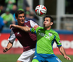 Seattle Sounders' Marco Pappa, right, is guarded by Colorado Rapids' Thomas Piermayr during an MLS match on April 26, 2014 in Seattle, Washington.  The Seattle Sounders beat the Colorado Rapids 4-1.  Jim Bryant Photo. ©2014. All Rights Reserved.