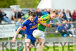 Cormac Cronin Spa and Dan Kerins John Mitchells tussle for the ball in the County Intermediate semi final in Killorglin on Saturday