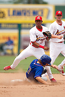 Domnit Bolivar (3) of the Springfield Cardinals turns a double play at second during a game against the Tulsa Drillers at Hammons Field on June 27, 2011 in Springfield, Missouri. (David Welker / Four Seam Images)
