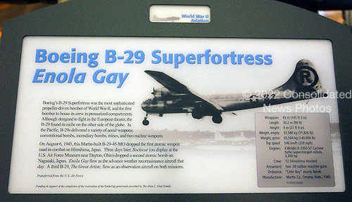 "Chantilly, Virginia - December 5, 2003 -- Controversial sign marking the ""Enola Gay"" exhibit at the Steven F. Udvar-Hazy Center of the National Air and Space Museum.  The is a simpler version of the description of the aircraft when parts of it were on display in the National Air and Space Museum's building on the National Mall in Washington, DC in 1994 - 1995 in connection with the 50th anniversary of the first use of the atomic bomb in warfare.   The museum text about the mission read: ""[Colonel Paul] Tibbets piloted the aircraft on its mission to drop an atomic bomb on Hiroshima [Japan] on August 6, 1945. That bomb and the one dropped on Nagasaki three days later destroyed much of the two cities and caused tens of thousands of deaths.""  ""However,"" the text continued, ""the use of the bombs led to the immediate surrender of Japan and made unnecessary the planned invasion of the Japanese home islands. Such an invasion, especially if undertaken for both main islands, would have led to very heavy casualties among American and Allied troops and Japanese civilians and military. It was thought highly unlikely that Japan, while in a very weakened military condition, would have surrendered unconditionally without such an invasion.""   The controversy concerning ""did the nuclear bomb hasten the end of the war or inflict massive casualties on the Japanese civilian population ?"" continues to the present time..Credit: Ron Sachs / CNP.(RESTRICTION: NO New York or New Jersey Newspapers or newspapers within a 75 mile radius of New York City)"