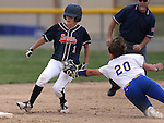 Wildcats shortstop Makaylee Jaussi dives to get the tag on Snow College's Emily Street during a game at Edmonds Sports Complex in Carson City, Nev., on Friday, March 20, 2015. <br /> Photo by Cathleen Allison/Nevada Photo Source
