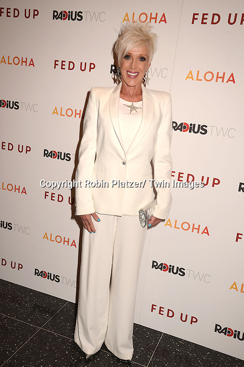 """High Voltage attends the New York Premiere of """"FED UP"""" on May 6, 2014 at The Museum of Modern Art in New York City."""