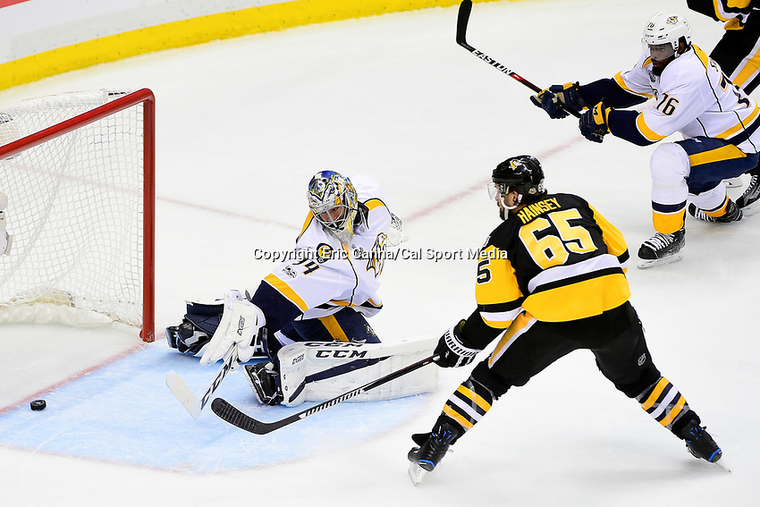 June 8, 2017: Pittsburgh Penguins defenseman Ron Hainsey (65) scores against Nashville Predators goalie Juuse Saros (74) during game five of the National Hockey League Stanley Cup Finals between the Nashville Predators  and the Pittsburgh Penguins, held at PPG Paints Arena, in Pittsburgh, PA. Pittsburgh defeats Nashville 6-0 to lead the series 3-2. Eric Canha/CSM
