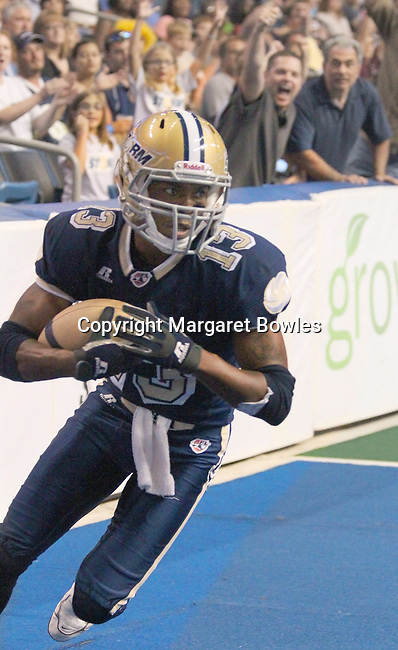 05 June 2010: Tampa Bay wide receiver DeAndrew Rubin takes the ball into the endzone for a Tampa Bay score. The Tampa Bay Storm defeated the Oklahoma City Yard Dawgz 50-48 at the St. Pete Forum in Tampa, Florida
