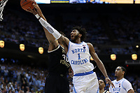 CHAPEL HILL, NC - MARCH 03: Olivier Sarr #30 of Wake Forest University blocks a layup by Leaky Black #1 of the University of North Carolina during a game between Wake Forest and North Carolina at Dean E. Smith Center on March 03, 2020 in Chapel Hill, North Carolina.