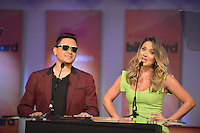 MIAMI, FL - FEBRUARY 05: Elvis Crespo and Kimberly Dos Ramos at the Telemundo and Premios Billboard 2013 Press Conference at Gibson Miami Showroom on February 5, 2013 in Miami, Florida. © MPI10/MediaPunch Inc /NortePhoto