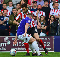 Lincoln City's Ollie Palmer vies for possession with Exeter City's Pierce Sweeney<br /> <br /> Photographer Andrew Vaughan/CameraSport<br /> <br /> The EFL Sky Bet League Two Play Off First Leg - Lincoln City v Exeter City - Saturday 12th May 2018 - Sincil Bank - Lincoln<br /> <br /> World Copyright &copy; 2018 CameraSport. All rights reserved. 43 Linden Ave. Countesthorpe. Leicester. England. LE8 5PG - Tel: +44 (0) 116 277 4147 - admin@camerasport.com - www.camerasport.com