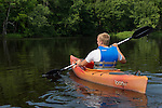 Teenager kayaking down the Flambeau River