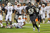 12 November 2011:  FIU linebacker Gregory Hickman (55) celebrates after tackling Florida Atlantic wide receiver D.J. Frye-Smith (20) to hold him to an 18-yard kickoff return in the first quarter as the FIU Golden Panthers defeated the Florida Atlantic University Owls, 41-7, to win the annual Shula Bowl game, at FIU Stadium in Miami, Florida.
