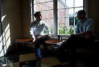 Chris Wong, Assistant Chaplain at the Kentucky Racetrack Chaplaincy, speaks with a friend at Southern Baptist Theological Seminary in Louisville, Ky. on April 29, 2014.