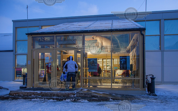 A polar bear on exhibition in a shop in the town of Longyear, Svalbard. <br /> <br /> Norway's polar bear population lives in and around Svalbard. Any global warming will affect the around 3000 polar bears in the area. <br /> <br /> <br /> Svalbard (formerly known by its Dutch name Spitsbergen) is a Norwegian archipelago in the Arctic Ocean. Situated north of mainland Europe, it is about midway between continental Norway and the North Pole. <br /> <br /> <br /> (photo: Fredrik Naumann/Felix Features)