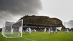 Rangers attack a corner kick under the gaze of Dumbarton Castle as they stroll to a 3-0 win at the Bet Butler Stadium