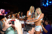 Miami Dolphins Cheerleaders sign calendars at Miami Dolphins Cheerleaders Swimsuit 2014 Calendar Unveiling and Fashion Show at Fontainebleau's LIV nightclub, Miami Beach, FL, September 5, 2013