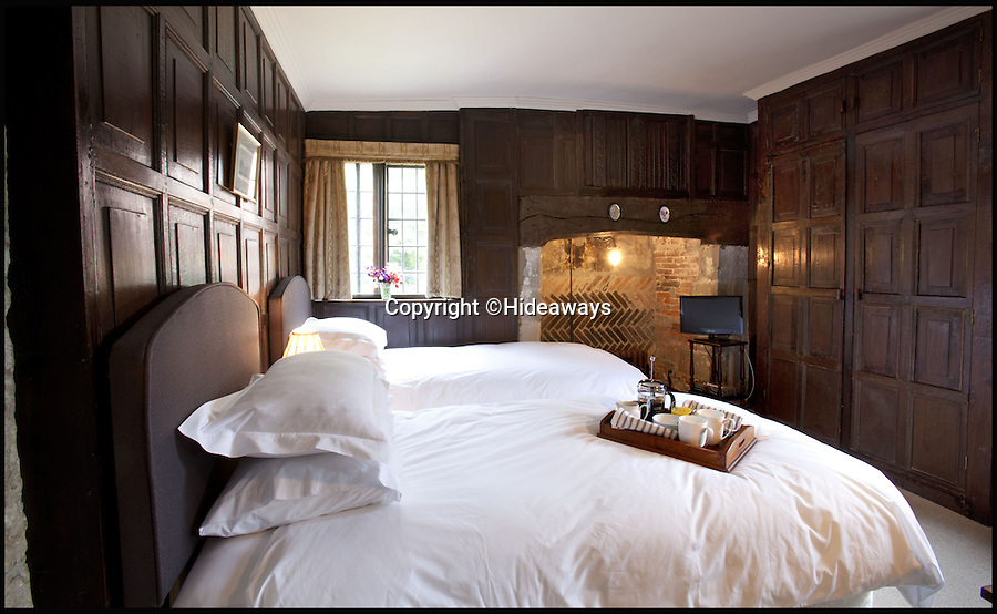 BNPS.co.uk (01202 558833)<br /> Pic: Hideaways/BNPS<br /> <br /> Period features - Oak panelled bedroom.<br /> <br /> You can now live like a king... but it will cost you £6,000 a week!<br /> <br /> This stunning historic house offers the ultimate 'Lord of the Manor' experience - but you'll need deep pockets to enjoy the life of luxury.<br /> <br /> The Grade II* listed King John's House has eight opulent bedrooms and exquisite period features dating back to medieval times, but staying there will set you back a whopping £5,682 per week.<br /> <br /> The site in Tollard Royal, Wiltshire, was once a Royal hunting lodge used by King John in the early 13th century but since the death of the last owner William Gronow Davis last year it has now become a very exclusive rental property for groups wanting to celebrate a milestone birthday or anniversary in style.
