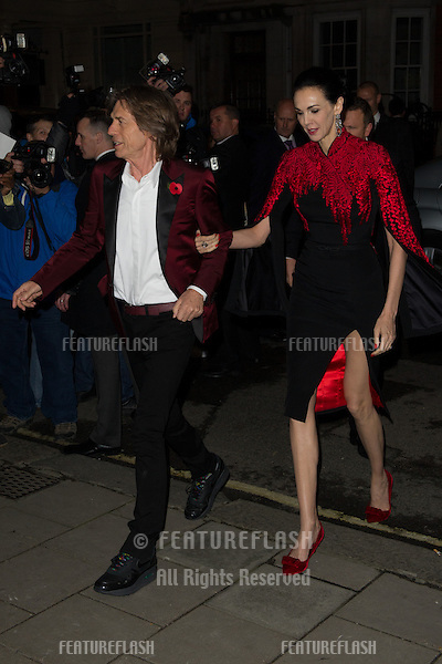 Mick Jagger and L'Wren Scott for the Harper's Bazaar Women of the Year Awards 2013<br /> Claridges Hotel, London. 05/11/2013 Picture by: Dave Norton / Featureflash