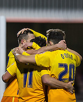 Teammates celebrate with goalscorer Paul Hayes (left) of Wycombe Wanderers during the Sky Bet League 2 match between Dagenham and Redbridge and Wycombe Wanderers at the London Borough of Barking and Dagenham Stadium, London, England on 9 February 2016. Photo by Andy Rowland.