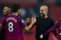 Manchester City manager Josep Guardiola celebrates with Ilkay Gundogan <br /> <br /> Photographer Craig Mercer/CameraSport<br /> <br /> The Premier League - Tottenham Hotspur v Manchester City - Saturday 14th April 2018 - Wembley Stadium - London<br /> <br /> World Copyright &copy; 2018 CameraSport. All rights reserved. 43 Linden Ave. Countesthorpe. Leicester. England. LE8 5PG - Tel: +44 (0) 116 277 4147 - admin@camerasport.com - www.camerasport.com