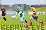 Damien Bourke of Na Gaeil about to hand pass the ball as Conor Kennelly of St Senans bears down on him, in the Junior Premier football championship final on Sunday.