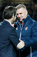 Dean Smith manager of Brentford welcomes Thomas Christiansen manager of Leeds United during the Sky Bet Championship match between Brentford and Leeds United at Griffin Park, London, England on 4 November 2017. Photo by Carlton Myrie.