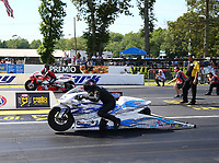 Jun 11, 2017; Englishtown , NJ, USA; NHRA pro stock motorcycle rider Jerry Savoie (near) races alongside Hector Arana Jr in the final round of the Summernationals at Old Bridge Township Raceway Park. Mandatory Credit: Mark J. Rebilas-USA TODAY Sports