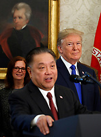 United States President Donald J. Trump looks on as Broadcom CEO Hock Tan announces his company,  Broadcom Limited, a semiconductor manufacturing company, is moving its headquarters from Singapore to the United States, in the Oval Office of the White House in Washington, DC on Thursday, November 2, 2017.  Broadcom Limited is a Fortune 100 company that currently employs over 7,500 workers in many states across the US.<br /> Credit: Martin H. Simon / Pool via CNP /MediaPunch