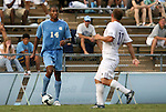 06 September 2009: UNC's Jordan Graye (14) and Evansville's Mike Luttrull (11). The University of North Carolina Tar Heels defeated the Evansville University Purple Aces 4-0 at Fetzer Field in Chapel Hill, North Carolina in an NCAA Division I Men's college soccer game.