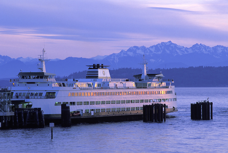 Washington State ferry Puyallup at dock in Edmonds, Washington, during sunset with Olympic Mountains in background