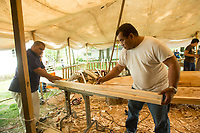 NWA Democrat-Gazette/BEN GOFF @NWABENGOFF<br /> Liton Beasa shapes a spar which will attach the outrigger to the main hull of the KorKor Tuesday, May 8, 2018, at the Shiloh Museum of Ozark History in Springdale. Master canoe builder Liton Beasa and his family, in partnership with the Shiloh Museum of Ozark History, began building the two-man Marshallese canoe called a KorKor April 14 and plan to display the finished canoe at the Little Craft Show Saturday in downtown Springdale.