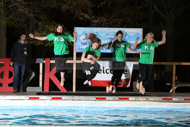 Kappa Delta jumpers go into the pool at the University of Kentucky Phi Sigma Kappa Polar Plunge philanthropy event at South Campus benefitting the Special Olympics in Lexington, Ky., on Thursday, November 14, 2013. Photo by Tessa Lighty | Staff