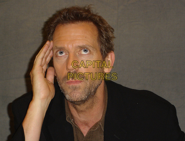 HUGH LAURIE.Photocall at the Peninsula Hotel in Beverly Hills, USA. .October 6th, 2006.Ref: AW.headshot portrait hand mouth open stubble beard.www.capitalpictures.com.sales@capitalpictures.com.©Anita Weber/Capital Pictures.