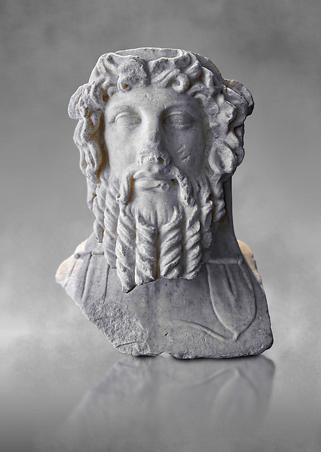 Double sided Roman herm of Dionysus from the mid 2nd cent. AD excavated from the via Sallustiani, Rome. This bust shows Dionysus with his traditional band around his head, he appears as a youthful man on one side and as a mature man with a beard on this sid.   The National Roman Museum, Rome, Italy