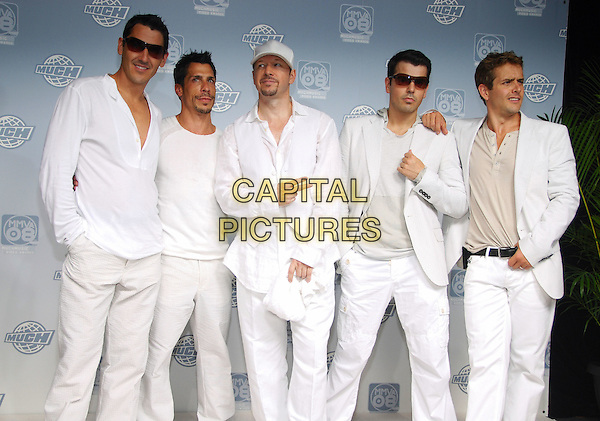 NEW KIDS ON THE BLOCK .JONATHAN KNIGHT, DANNY WOOD, DONNIE WHALBERG, JORDAN KNIGHT, JOEY McINTYRE.attend the 19th Annual MuchMusic Video Awards held at Chum City Building, Toronto, Ontario, Canada, 15 June 2008..NKOTB all white outfits reformed boy band half length group band sunglasses hat.CAP/ADM/BPC.©Brent Perniac/Admedia/Capital Pictures