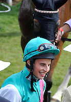 03.08.2013 Goodwood, England.  Winner's enclosure during day five of the  Glorious Goodwood Festival. Winner of the Feature race 3.15 The Markel Insurance Nassau Stakes (British Championship Series). Group 1- Jockey William Buick with his ride Winsili in the background