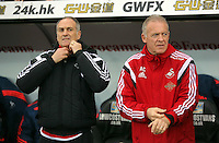 (L-R) Swansea head coach Francesco Guidolin with Swansea interim manager Alan Curtis during the Barclays Premier League match between Swansea City and Crystal Palace at the Liberty Stadium, Swansea on February 06 2016
