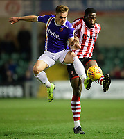 Lincoln City's John Akinde vies for possession with Exeter City's Archie Collins<br /> <br /> Photographer Chris Vaughan/CameraSport<br /> <br /> The EFL Sky Bet League Two - Lincoln City v Exeter City - Tuesday 26th February 2019 - Sincil Bank - Lincoln<br /> <br /> World Copyright © 2019 CameraSport. All rights reserved. 43 Linden Ave. Countesthorpe. Leicester. England. LE8 5PG - Tel: +44 (0) 116 277 4147 - admin@camerasport.com - www.camerasport.com