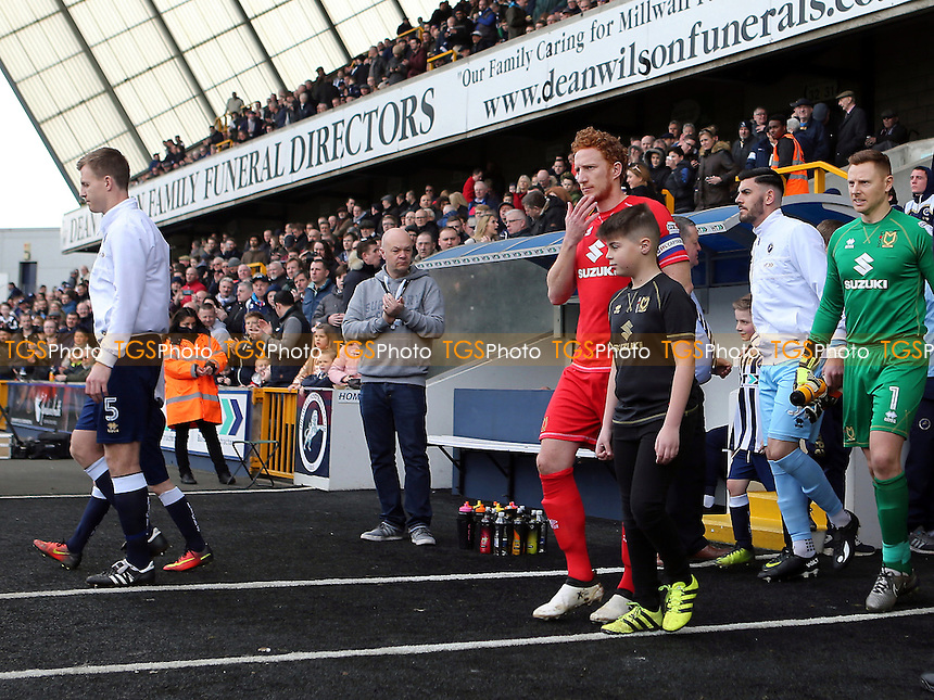 Dean Lewington leads out the MK Dons team during Millwall vs MK Dons, Sky Bet EFL League 1 Football at The Den on 4th March 2017