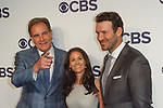 Left to right, Jim Nantz, Tracy Wolfson and Tony Romo arrive at the CBS Upfront at The Plaza Hotel in New York City on May 17, 2017.