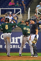 Lynchburg Hillcats Yu-Cheng Chang (6) is congratulated by Bobby Bradley (44) after hitting a home run as catcher Chad Johnson looks on during a game against the Wilmington Blue Rocks on June 3, 2016 at Judy Johnson Field at Daniel S. Frawley Stadium in Wilmington, Delaware.  Lynchburg defeated Wilmington 16-11 in ten innings.  (Mike Janes/Four Seam Images)
