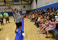 NWA Democrat-Gazette/FLIP PUTTHOFF <br />FITNESS CHALLENGE<br />Kari Fletcher, athletic director at the Benton County Boys & Girls Club in Bentonville, lays out the rules Wednesday May 10 2017 for the Nestle Boys & Girls Club Fitness Challenge held at the club. Kids took part in several fitness events, including jump rope, push ups, basketball and sit ups. The fitness challenge is a national event at 750 Boys & Girls Clubs that involves about 75,000 youngsters, said Ginger Brooks with Nestle USA.