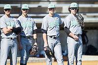 (L-R) Eric Escobedo (12), Robert Fajardo (26), Corey Bird (31) and Chase Vogelbach (7) watch the end of infield practice prior to the game against the Georgetown Hoyas at Wake Forest Baseball Park on February 15, 2014 in Winston-Salem, North Carolina.  The Thundering Herd defeated the Hoyas 5-1.  (Brian Westerholt/Four Seam Images)